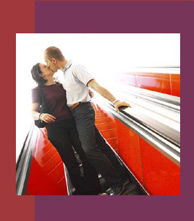 Couple kissing on escalator - Relationship Counseling L.A.